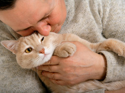 Woman hugging cat 9-2011